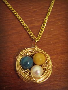 HANDMADE Blue, Yellow, and Pearl Bird's Nest Necklace in Gold ($15)