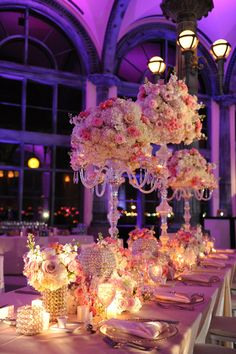 Pink green and white wedding decor with crystal accents and purple pink uplighting | Photo: Unique Design Studios