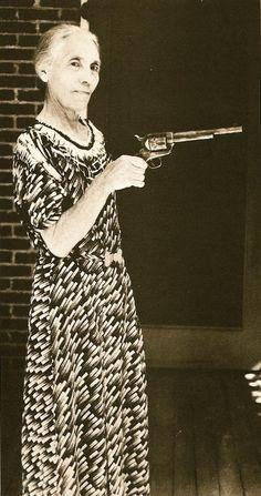 Ms. Apolinaria Gutierrez Garrett, wife of famous frontier sheriff Pat Garrett, holding the gun he used in 1881 to kill Billy the Kid. Photo circa 1920.: