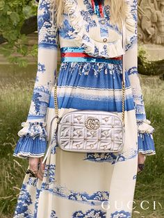Gardens influence prints on silk gowns from the Gucci Cruise 2017 collection by Alessandro Michele, together with a GG Marmont matelassé bag with chain shoulder strap.