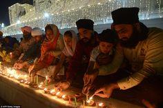 Sikh devotees lighting candles during Bandi Chhor Divas, or Diwali, at the Golden Temple i...