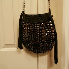 FREE PEOPLE CROSSBODY BLACK LEATHER HANDBAG Great preloved condition. Black leather with tassles. Second and third pictures are from FREE PEOPLE website. First pic is actual bag. It is missing 5 studs but it still perfectly balanced even with that looks as though it's made that way. Gorgeous bag Free People Bags Crossbody Bags