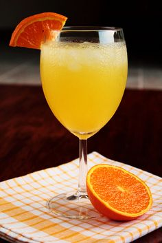Tropical Vacation  1/3 cup pineapple juice  2 ounces Malibu Rum (or other coconut rum)  1 ounce Triple Sec (or other orange liqueur)  5-6 ice cubes