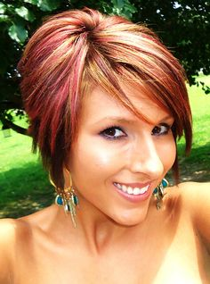 short bob/long pixie red highlights. Not so much the color but the cut is way cute!