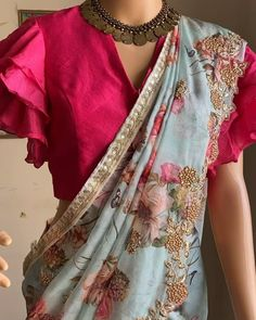 Beautiful floral organza saree in ice blue color with cut work embroidery all over it paired with hot pink multi layered ruffle sleeves blouse ! Can be mix and matched with our designer blouse collec Half Saree Designs, Saree Blouse Neck Designs, Fancy Blouse Designs, Bridal Blouse Designs, Back Design Of Blouse, Pattern Blouses For Sarees, Cutwork Blouse Designs, Henna Designs, Anarkali