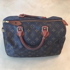 Authentic Louis Vuitton Speedy 30 Monogram Bag Pre-owned in good condition. The handles and leather accents have darkened to a beautiful shade of patina. The brass studs have oxidized which is an indication of real brass and authenticity of the hardware. Comes with original lock but no key. Pen staining on the interior of the bag. The coding suggests that this bag was manufactured in France in 6/2004. Original dustbag not included. I have recently pulled this bag out of storage and used…
