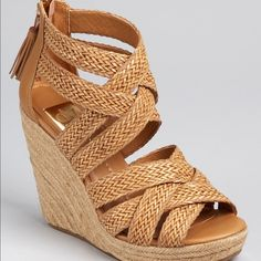 """DV By Dolce Vita Tulle Woven Espadrille Boho chic woven wedges by Dolce Vita. Brand new & NEVER WORN. Pair with a flirty summer sundress or your favorite maxi! Features tan woven straps, heel zips, back tassels and espadrille platform. Manmade upper & sole Platform measures approximately 1"""" Heel measures approx. 5"""" DV by Dolce Vita Shoes Espadrilles"""