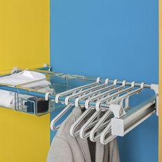 The Ambos Pull Out Hanger System provides hanging storage on a convenient pull out unit and is a practical option for managing a mix of jackets, shirts, dresses, trousers and skirts. It's can be installed under shelves and can be  combined with the Ambos pull out polycarbonate drawer system (as shown here). Adjustable width from 750-1150mm, including supports. Order pull out frame and hangers separately. Hangers have a handy loop to hold belts, ties, scarves.