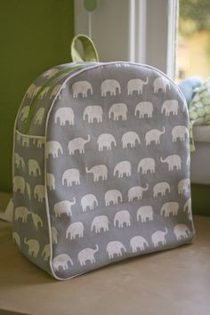 I want to make this toddler backpack for my friend's little girl!  She's only 10 months now, but one day she can tote it around.  I want that exact fabric/color combo and everything!