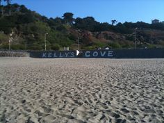 """Kelly's Cove at Ocean Beach, San Francisco. Kelly's Cove is a popular surfing spot for the fearless. This is along the stretch of beach where Emma disappears. """"We'd pick up sandwiches at Joe's Deli and take them down to Ocean Beach, where we'd watch intrepid surfers battling the wild breaks at Kelly's Cove."""" (page 131) Notice the tagging. Crews are constantly cleaning up tagging along the seawall at Ocean Beach, but new graffiti always appears the next day."""