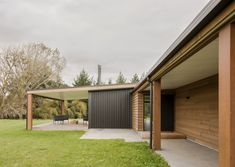 Covered entry walk from the motor court. Cedar cladding contrasting against Black Vertical Metal Cladding. Black aluminium joinery with Colorsteel longrun roofing. Auckland Waikato Coromandel