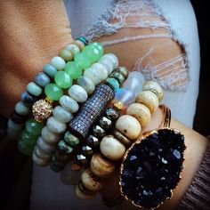 These stacked beaded bracelets are so pretty. Love that big druzy stone bracelet
