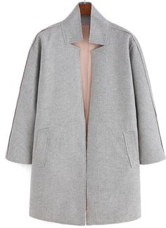 We love the stand collar cut of this light grey coat! Get the look on ShopStyle