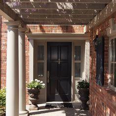 Reclaimed red brick, white trim/ windows black door. Another love!
