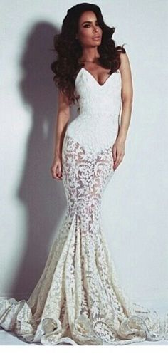 Michael Costello. Gorgeous lace dress though a little too casual for a wedding. Engagement dress maybe.