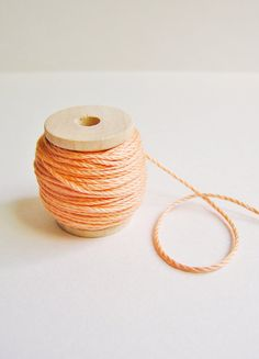 Peach cotton bakers twine trim on a wood Spool -15 yards