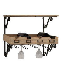 This elegantly designed shelf stores four bottles of wine while providing additional shelving for spices or cookware and hanging storage for white and red wine glasses.