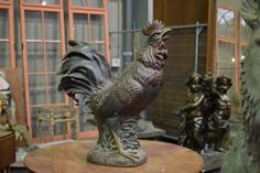 Nice Terracotta Rooster statue from 1880 in good condition. Discover more beautiful items from Christophe Prouveur's collection, a professional Belgian antique dealer, on Transferantique. Statues, Rooster Statue, Terracotta, Lion Sculpture, Nice, Antiques, Beautiful, Collection, Things To Sell