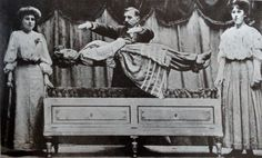 Signor Martino uses his powers to levitate Mademoiselle Nita on stage, 1900