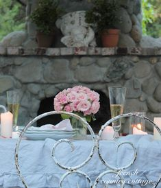FRENCH COUNTRY COTTAGE: Romantic Table Setting, pale blue cloth with pink flowers.
