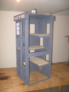 """This """"Doctor Who"""" Tardis cat condo may not be bigger on the inside than the outside, but it does have three levels."""