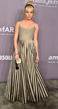 Sienna Miller in Dior Couture attends the 2018 amfAR Gala in NYC. #bestdressed