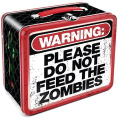 Don't Feed the Zombies! Embossed tin lunch box proclaiming that you shouldn't feed the zombies. I hope you knew that anyway. Lunch Box measures inches tall x inches wide x 4 inches Tin Lunch Boxes, Vintage Lunch Boxes, Zombies, Zombie Gifts, Zombie Apocolypse, Apocalypse, Zombie Attack, Whats For Lunch, Metal Tins