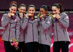 (L-R) McKayla Maroney, Kyla Ross, Alexandra Raisman, Gabrielle Douglas and Jordyn Wieber of the United States celebrate after winning the gold medal in the Artistic Gymnastics Women's Team final on Day 4 of the London 2012 Olympic Games at North Greenwich Arena on July 31, 2012 in London, England.