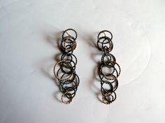 Arracades de plata oxidada  i or.