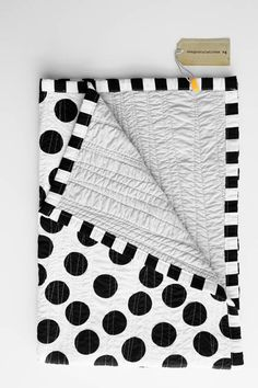 Black and white cot quilt