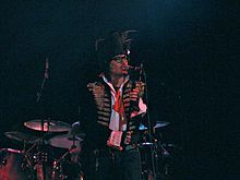 Adam Ant (born Stuart Leslie Goddard, 3 November 1954, Marylebone, London) is an English musician who gained popularity as the lead singer of New Wave/post-punk group Adam and the Ants and later as a solo artist, scoring ten UK top ten hits between 1980 and 1983, including three No.1s. Ant was also a star in America where he not only scored a string of hit singles and albums, but was once voted sexiest man in America by the viewers of MTV. He is also an...