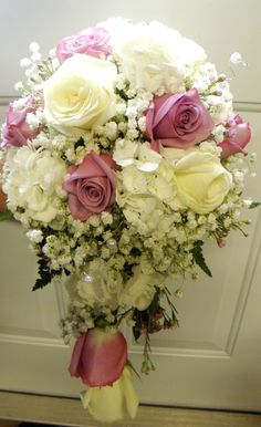 Romantic Cascade Bouquet of lavender & white roses, babys breath, white hydrangea, lavender waxflower & white pearls by Donna Kay's Bouquets at www.donnakaysbouquet.co