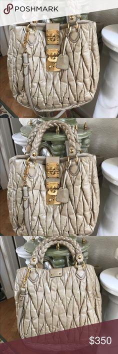 Miu Miu Shoulder/Handbag Authentic MiuMiu Shoulder/Tote Bag, Preowned and preLoved condition. Comes with dust bag, removable strap, beige color Miu Miu Bags Shoulder Bags
