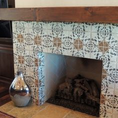 Simple treatment for Master Bedroom fireplace using the 4 piece pattern that coordinates w bathroom tile. Love the reclaimed mantle!