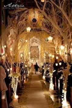 Candlelit isle for wedding.    How romantic.