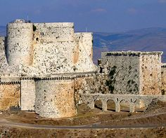 """Krak des Chevaliers (Crac Des Chevaliers),  Talkalakh District, Syria...    www.castlesandmanorhouses.com   ...    The site was settled in the 11th century by Kurds; as a result it was known as Hisn al Akrad, meaning the """"Castle of the Kurds"""". In 1142 it was given by Raymond II, Count of Tripoli, to the Knights Hospitaller. The crusader castle remained in their possession until it fell in 1271. It was known as Crac de l'Ospital (the name Krak des Chevaliers was coined only in the 19th…"""