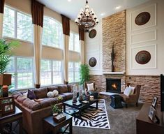 New home family room décor ideas.Toll Brothers - Soaring two-story family room with ample space for entertaining.
