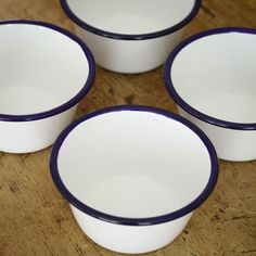 "A wonderful and terribly useful set of four classic enamel bowls. These make excellent breakfast or soup bowls, and are perfect for dining al fresco. We love to use these as individual pudding and pot pie bowls, as they are very happy to go in the oven. Also great for kids, as enamel is nearly impossible to break. White with blue rim. 5"" diameter x 3"" tall. Dishwasher and oven safe. Lead and Cadmium Free."