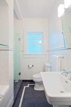 I like the inset of the white boarder.  Bathroom black and white tile Design Ideas, Pictures, Remodel and Decor