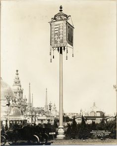 "Lighting standard decorated with Spanish coat of arms at the Panama-Pacific International Exposition (1915) On front: ""Banner standard for General Electric ornamental luminous arc lamps at P.P.I.E."" (via San Francisco Public Library)"