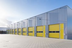 Photo about Exterior of a commercial warehouse with yellow roller doors. Image of import, architecture, dispatch - 39473643 Industrial Sheds, Parque Industrial, Industrial Architecture, Bamboo Architecture, Industrial Park, Conception D'entrepôts, Pre Engineered Steel Buildings, Roof Cladding, Cladding Ideas