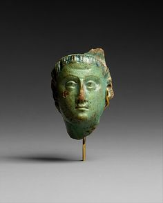 Head, Ptolemy III (?) 222-246  B.C, reign of Ptolemy III, Euergetes I, Egypt. (Faïence, English name for fine tin glazed pottery on a delicate pale buff earthenware body.)