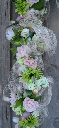 Easter Garland, Spring Swag, Floral Garland, Pastel Eggs, Easter Centerpiece    Easter Egg Floral Garland. Lush Hydrangeas in mint green, delicate pale pink Roses, soft white Tulips and vivid green Gerbera Daises mingle with a bounty of pastel Easter eggs. Natural Sinamay woven with silver threads swirls among the blooms and eggs to create this lovely Easter garland. Perfect to grace your mantle, tabletop or around a door or window.    Realistic, high-quality silk floral and greenery…