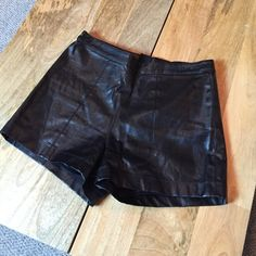 High waisted pleather shorts Faux leather high waisted shorts! I love these, but they're a little too tight on my thighs. Sorry these don't look too great in the photographs. Shorts Skorts