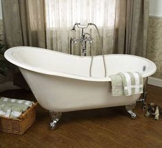 Barclay CTSH60 Cast Iron Slipper Soaking Tub.  Note center mount faucet.