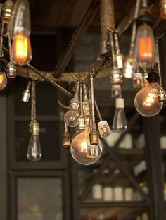 Chandelier from vintage pot rack and exposed bulbs