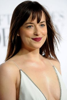 Pin for Later: Dakota Johnson's White Gown Is the Sexiest Thing We've Ever Seen Her In  Sometimes, some studs are all you need.