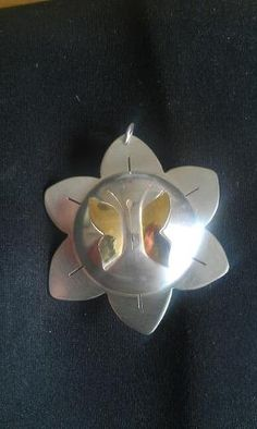 Sterling silver and Kuem Boo hand sawn butterfly on flower hollow bead pendant made by Claudine Peet