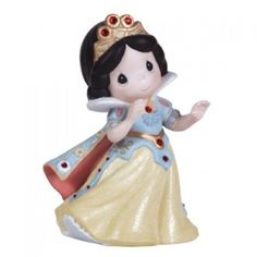 Echoing Snow White's innocence, purity and kindness, this Precious Moments girl is dressed as Disney's first and youngest princess. With her cape flowing behind her, she appears ready to dance to a ha
