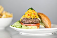 New favorite dish added from Contributing Chef Homaro Cantu. #Farmer #burger from Flip Burger Boutique. #grassfed #beef #patty #tomato #chowchow #pickled #relish #bibb #lettuce #mayo #thomasville #tomme #cheese #cheeseburger #fries #lunch #dinner #justfood #chicago #chefsfeed